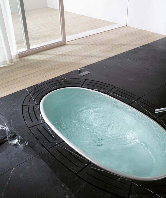 Luxe inbouw whirlpool met natuursteen ombouw